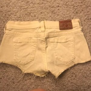 Yellow true religion booty shorts.